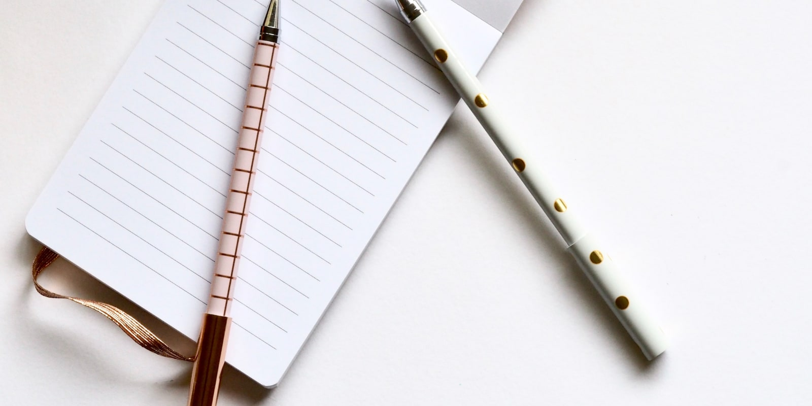 notebook and two pens
