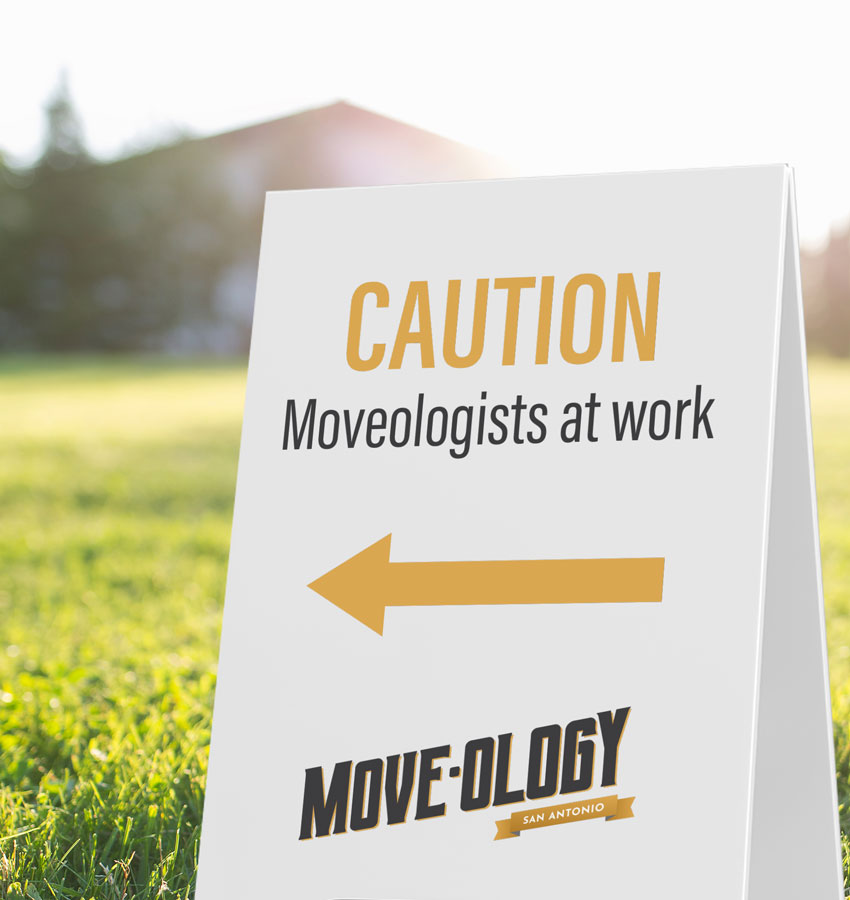 Moveology A-frame caution sign by a field