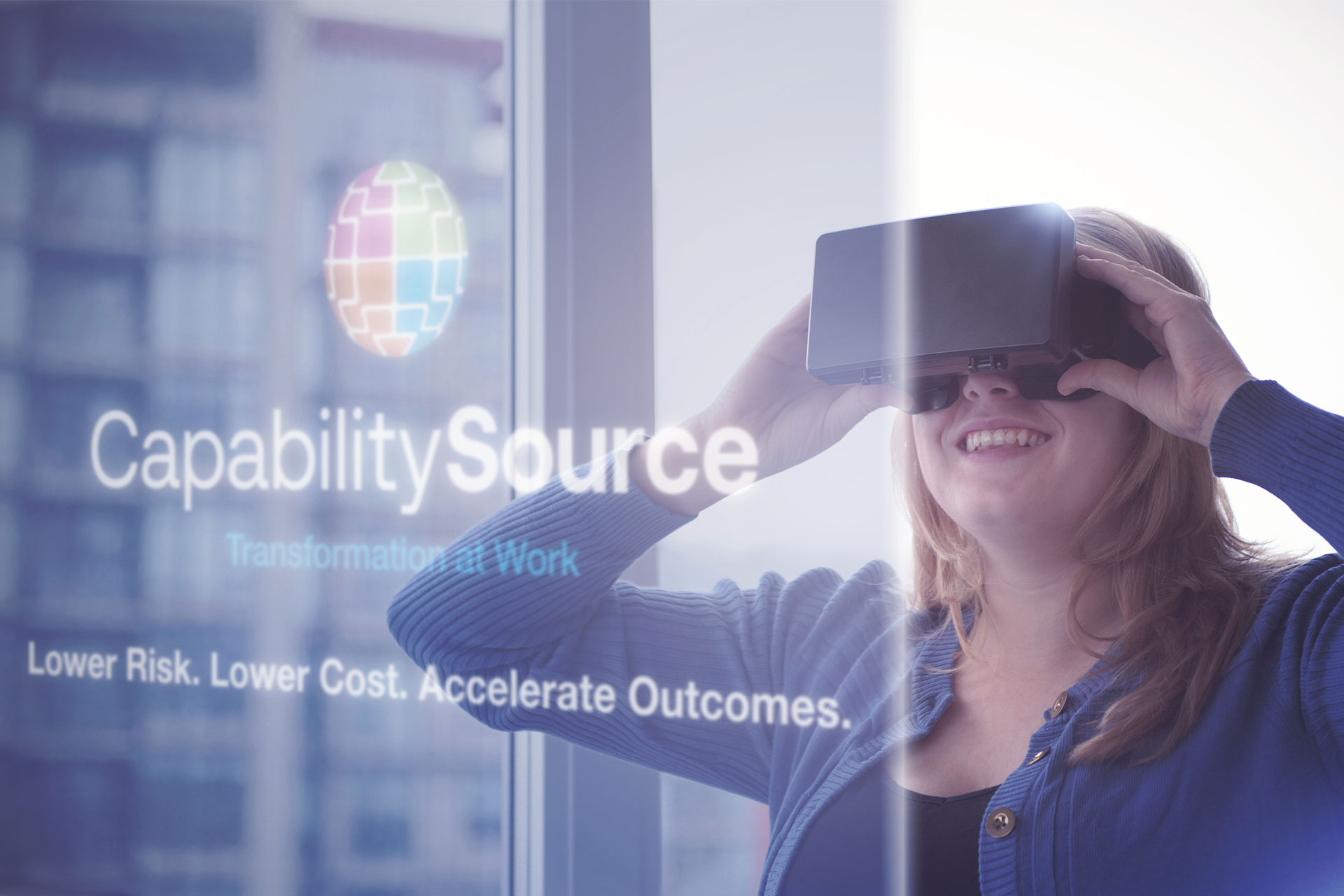 Woman looking through VR goggles at the CapabilitySource site