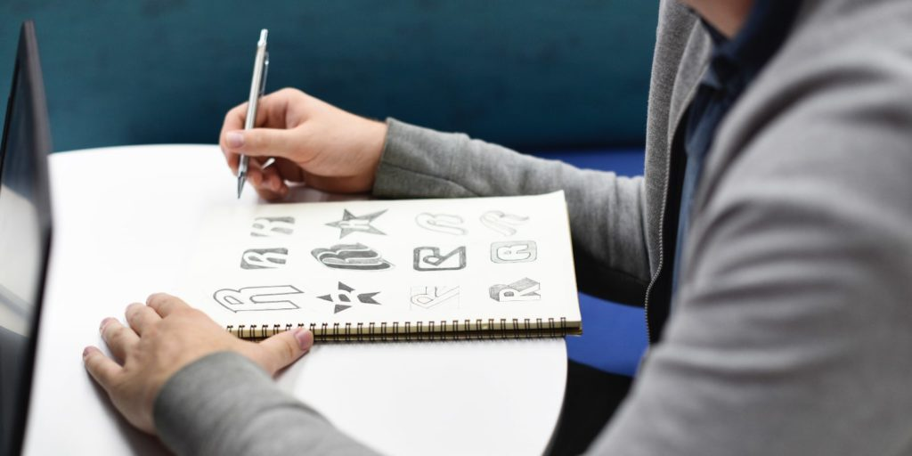 Designer sketching different brand ideas