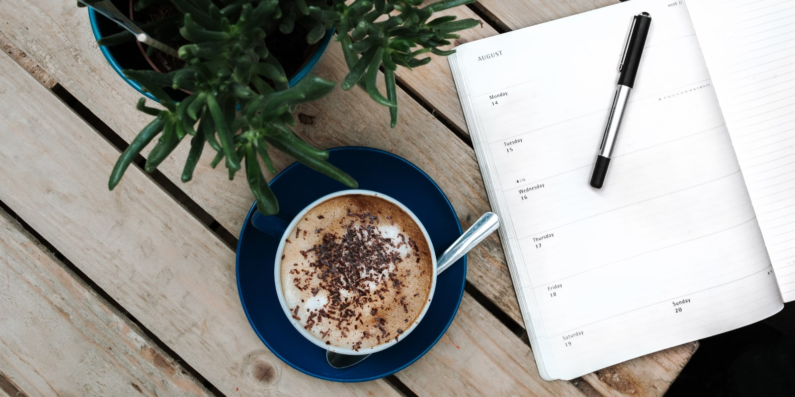 Cup of coffee and a weekly planner